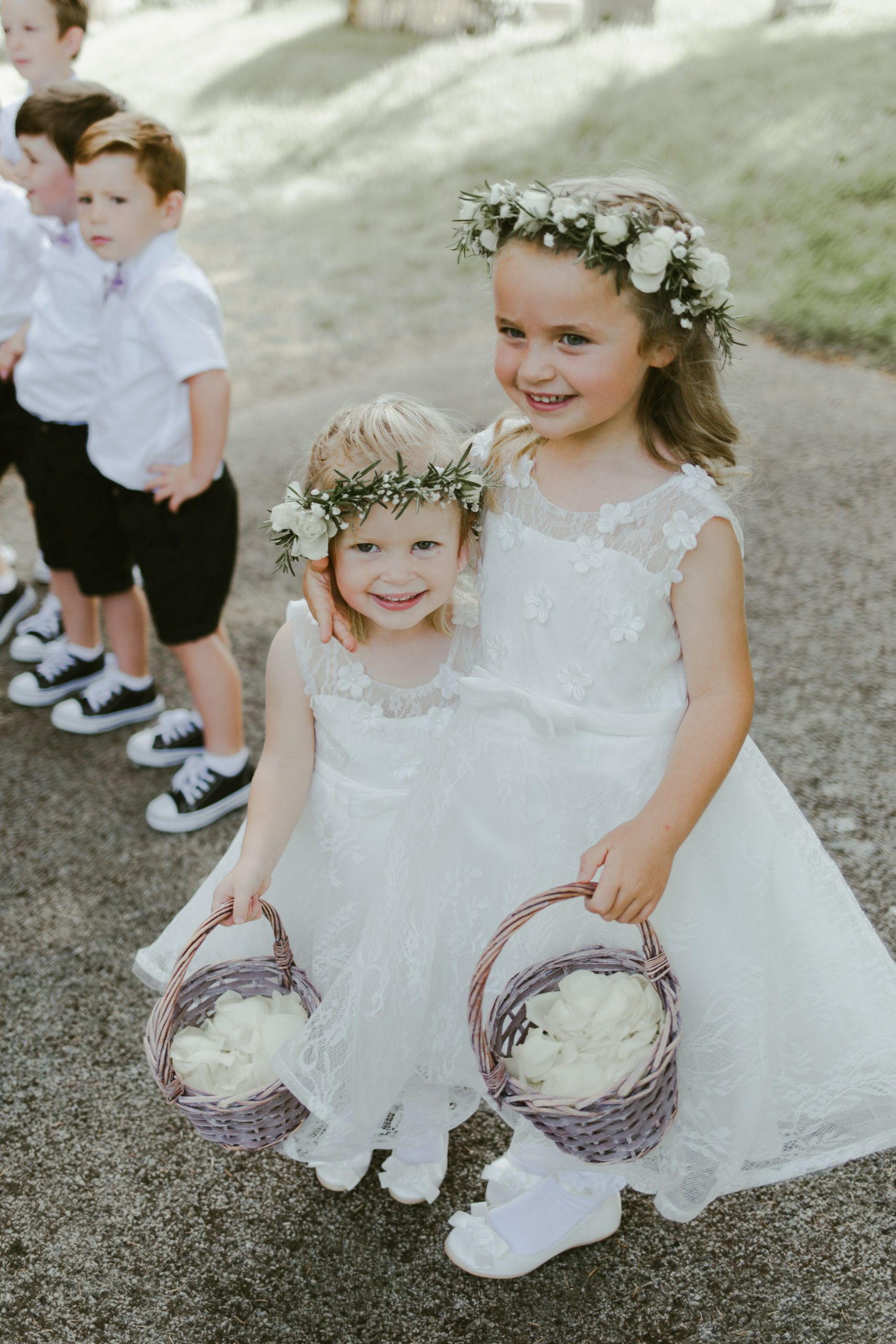wedding church ceremony bride and groom bridesmaids flower girls