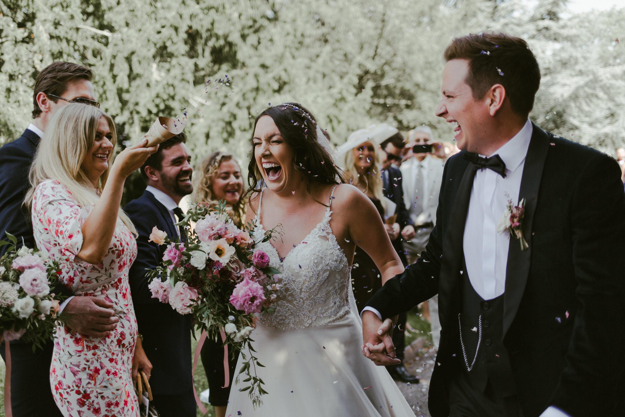 wedding church ceremony bride and groom confetti