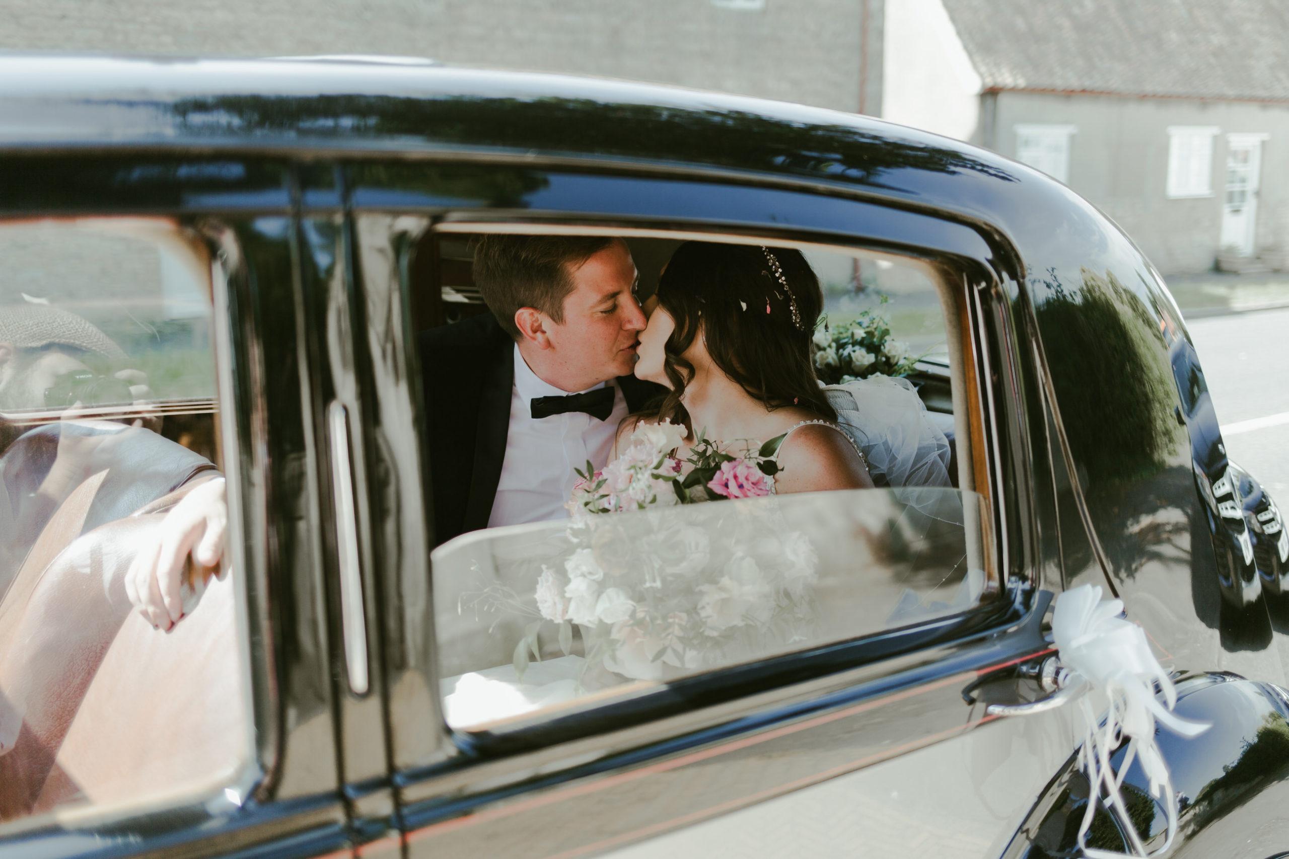 wedding car church ceremony bride and groom
