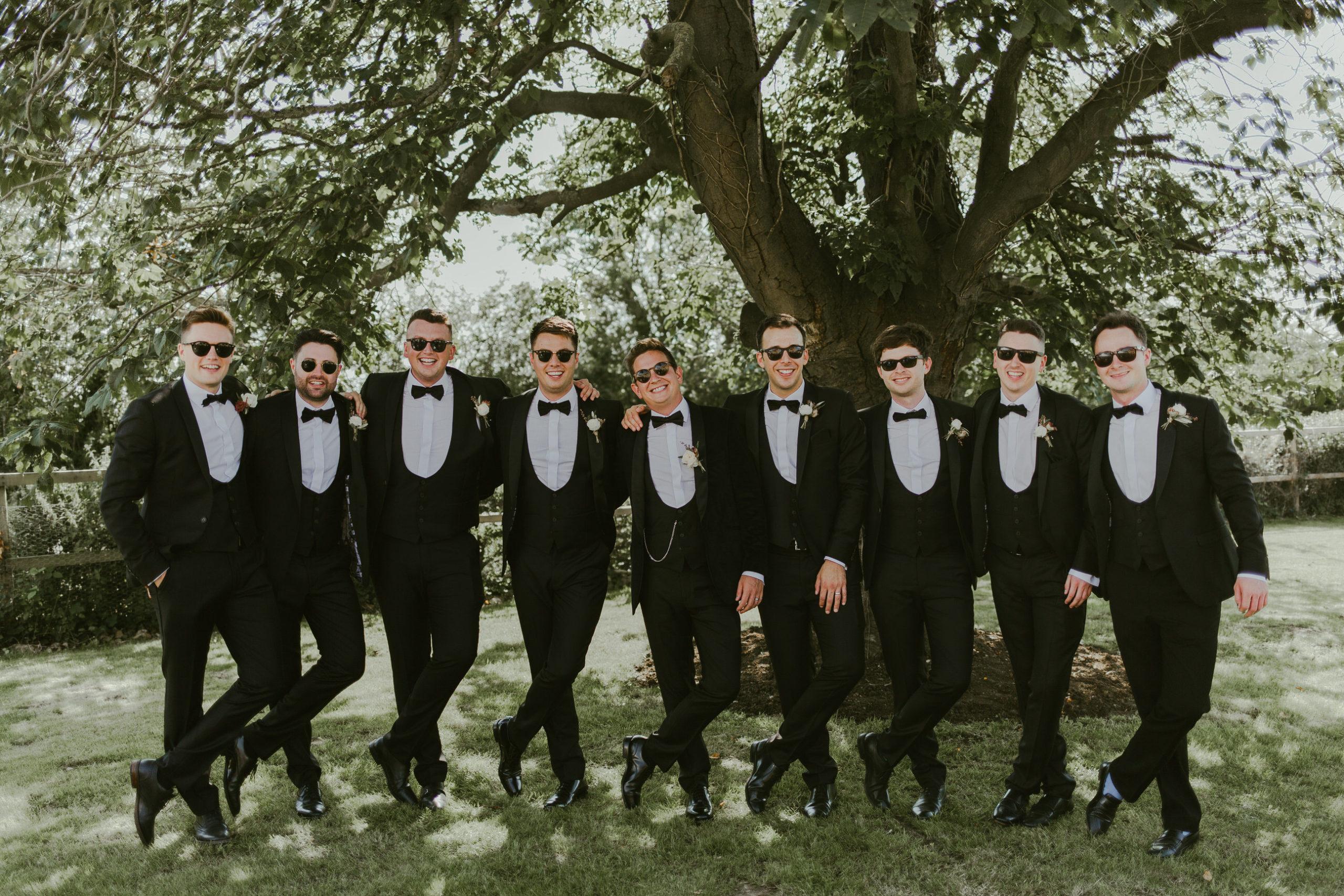 summer back garden wedding marquee groomsmen bridal party group photos
