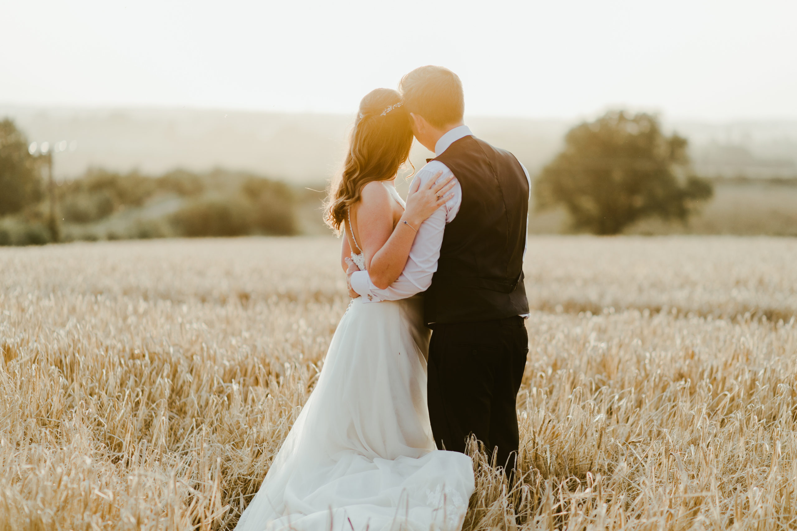 summer back garden marquee wedding bride and groom cornfield at sunset