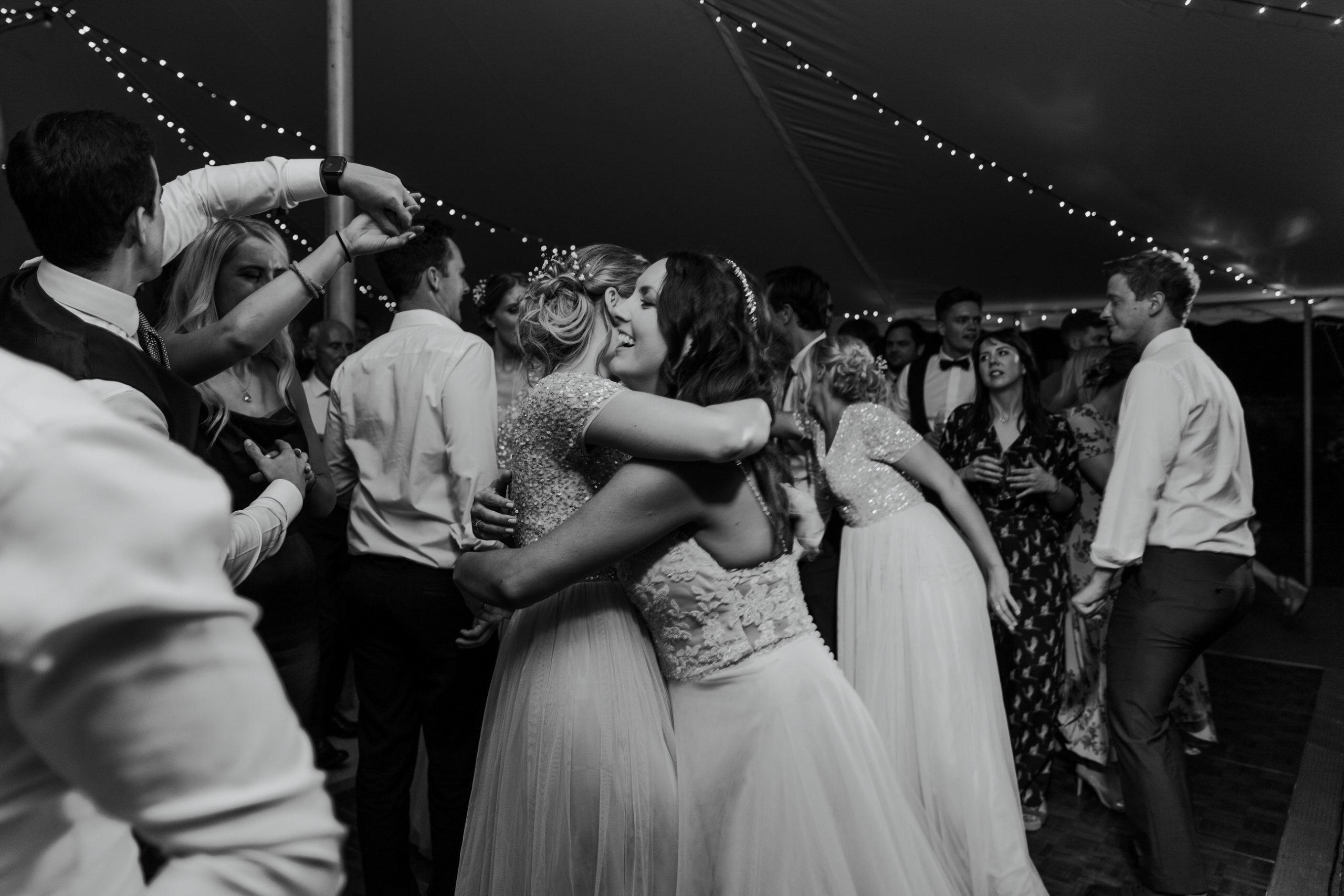 wedding party dance floor bride bridesmaids love dancing