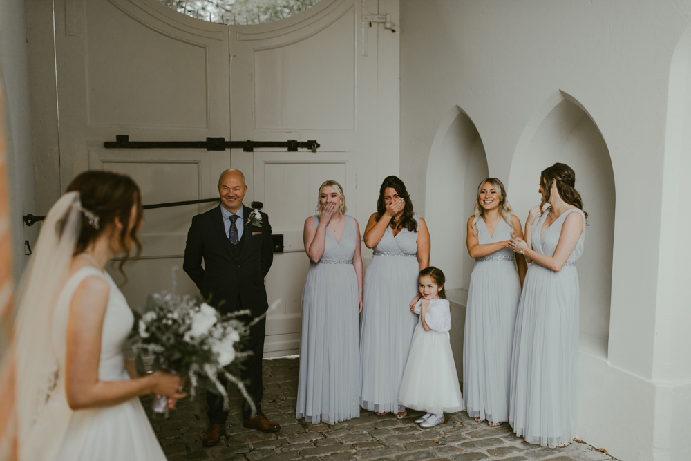 farnham castle bride reveal to bridal party and bridesmaids at the gatehouse
