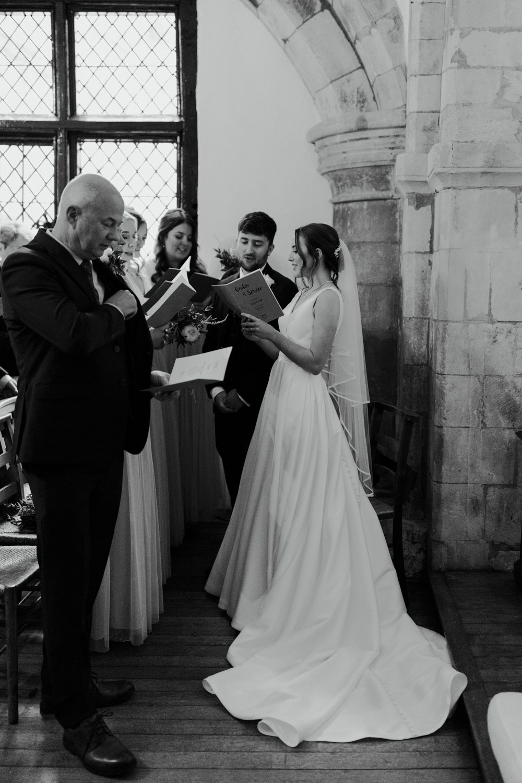 farnham castle wedding chapel ceremony bride and groom