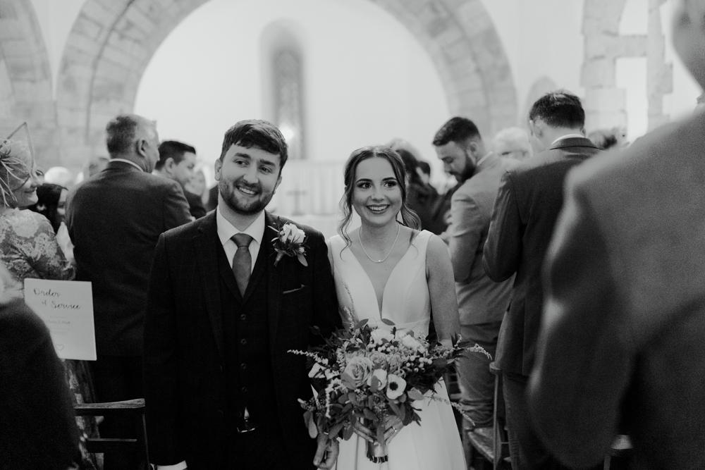 farnham castle wedding chapel ceremony bride and groom exit