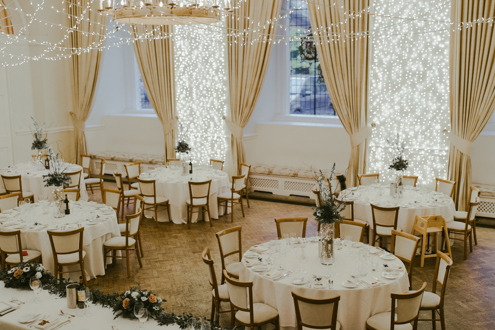 farnham castle wedding breakfast set up great hall fairy lights