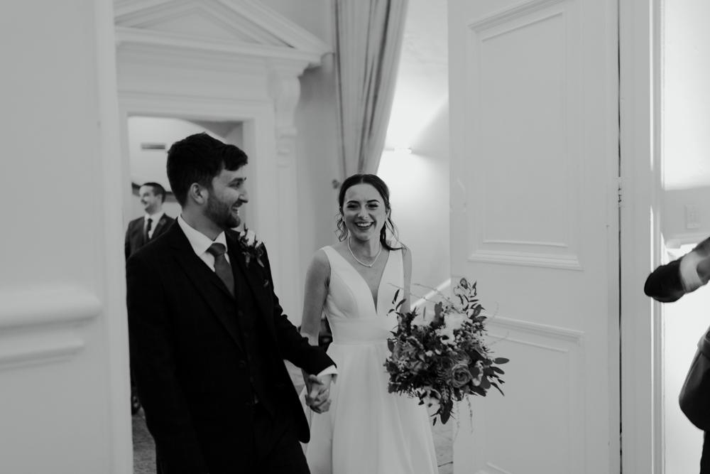 farnham castle weddings bride and groom wedding breakfast entrance